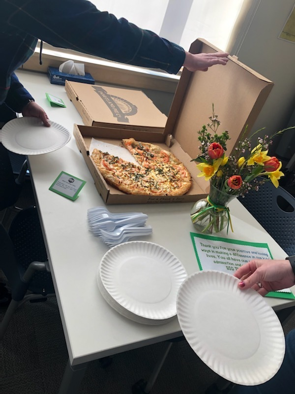 Pizza, plates, flowers